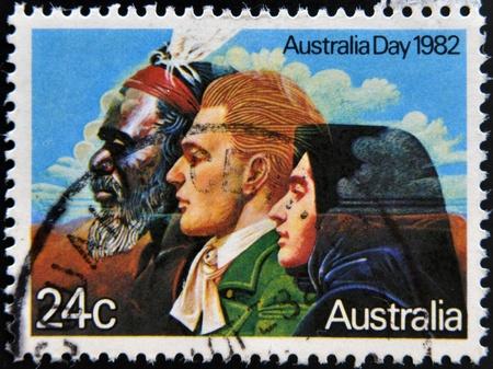aborigines: AUSTRALIA - CIRCA 1982: A stamp shows image of a Australian Aborigines and English messioner, circa 1982