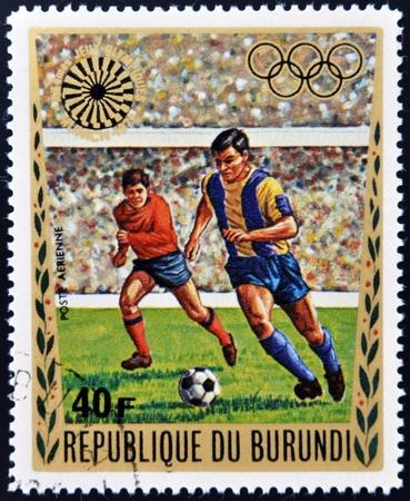 BURUNDI - CIRCA 1972: A stamp printed in Burundi dedicated to the Munich Olympics, shows football, circa 1972
