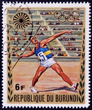 BURUNDI - CIRCA 1972: A stamp printed in Burundi dedicated to the Munich Olympics, shows javelin, circa 1972