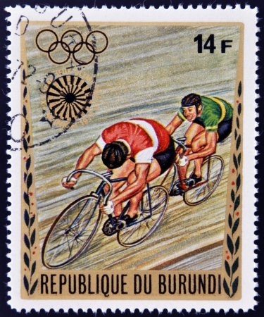 BURUNDI - CIRCA 1972: A stamp printed in Burundi dedicated to the Munich Olympics, shows cyclist, circa 1972