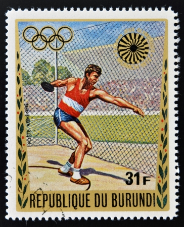 BURUNDI - CIRCA 1972: A stamp printed in Burundi dedicated to the Munich Olympics, shows discus throw, circa 1972 Stock Photo - 17297738