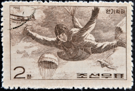 CHINA - CIRCA 1966: A stamp printed in China shows paratrooper in fall, circa 1966  photo