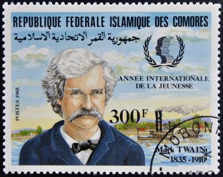 twain: FEDERAL ISLAMIC REPUBLIC COMOROS - CIRCA 1985: A stamp printed in Comoros shows Mark Twain, circa 1985