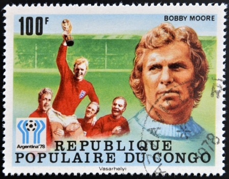CONGO - CIRCA 1978: A stamp printed in Congo dedicated to the World Cup in Argentina 1978, shows Bobby Moore, circa 1978 Stock Photo - 17297730