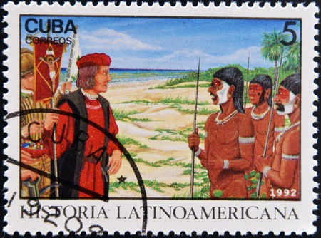 CUBA - CIRCA 1992: A stamp printed in cuba dedicated to Latin American history, shows Columbus Meeting natives, circa 1992  photo