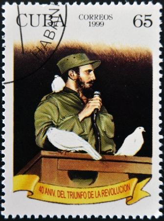 castro: CUBA - CIRCA 1999: A stamp printed in cuba shows Fidel Castro in Havana entrance with a dove perched on her shoulder, circa 1999  Editorial