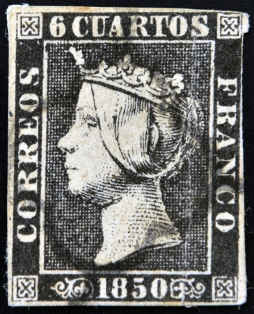 SPAIN - CIRCA 1850: first stamp printed in Spain shows Queen Elizabeth II, circa 1850