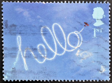 UNITED KINGDOM - CIRCA 2002: A stamp printed in Great Britain shows Aircraft Sky-writing hello, circa 2002 Stock Photo