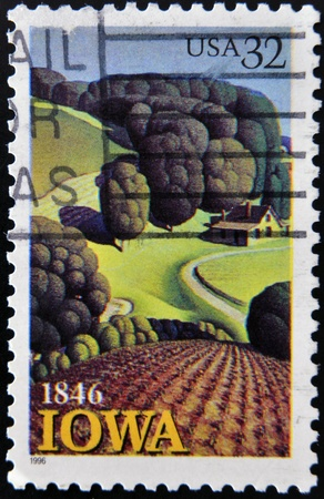 iowa agriculture: UNITED STATES OF AMERICA - CIRCA 1996: A Stamp printed in USA shows the Young Corn, by Grant Wood, Iowa Statehood, circa 1996