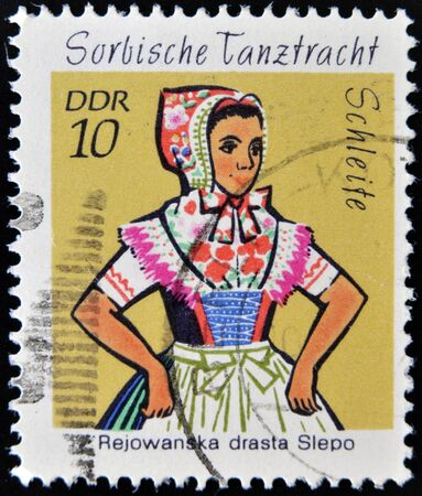 EAST GERMANY- CIRCA 1971: stamp printed in Germany shows Dance Costume Schleife, circa 1971.