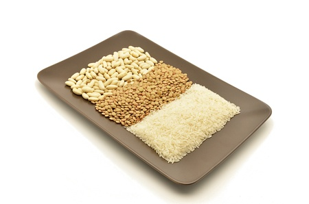 various legumes on a plate (lentils, rice and beans) photo