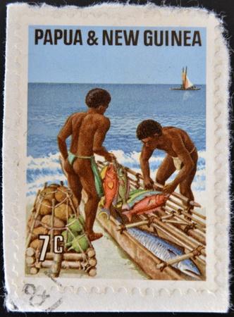 PAPUA NEW GUINEA - CIRCA 1971: A stamp printed in Papua shows fishermen, circa 1971 Stock Photo - 17522608
