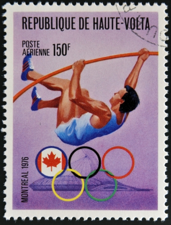 BURKINA FASO - CIRCA 1976: stamp printed in Burkina Faso, shows Olympic emblem and Pole vault, circa 1976
