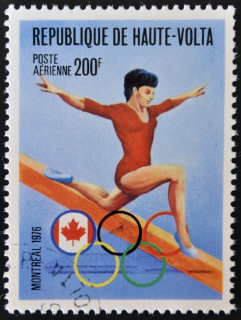 BURKINA FASO - CIRCA 1976: stamp printed in Burkina Faso, shows Olympic emblem and vault, circa 1976