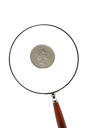 English one pound coin behind a magnifying glass  photo