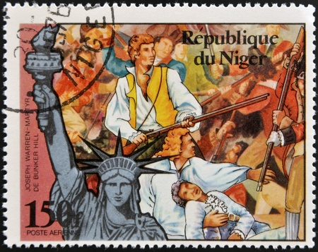 NIGER - CIRCA 1976: stamp printed in Niger shows Statue of Liberty and Joseph Warren, martyr of Bunker Hill, circa 1976  Stock Photo - 17742043