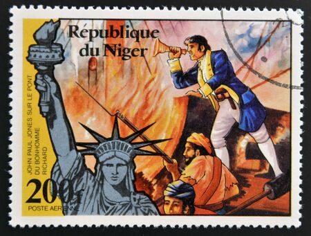 NIGER - CIRCA 1976: stamp printed in Niger shows Statue of Liberty and john paul jones, circa 1976  Stock Photo - 17742060