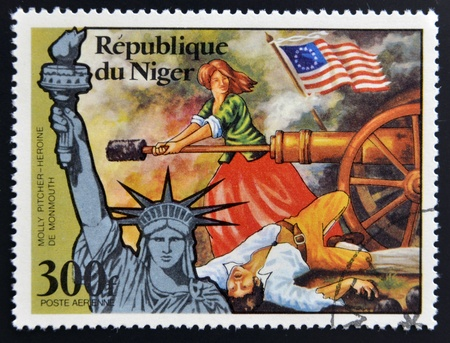 NIGER - CIRCA 1976: stamp printed in Niger shows Statue of Liberty and Molly Pitcher, Heroine of Monmouth, circa 1976 Stock Photo - 17744739