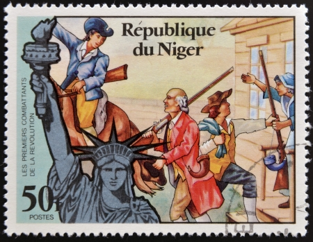 NIGER - CIRCA 1976: stamp printed in Niger shows Statue of Liberty and the first fighters of the Revolution, circa 1976 Stock Photo - 17745667