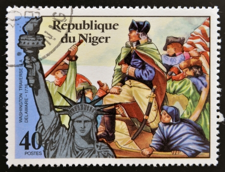NIGER - CIRCA 1976: stamp printed in Niger shows Statue of Liberty and Washington traverse the Delaware, circa 1976  Stock Photo - 17744738