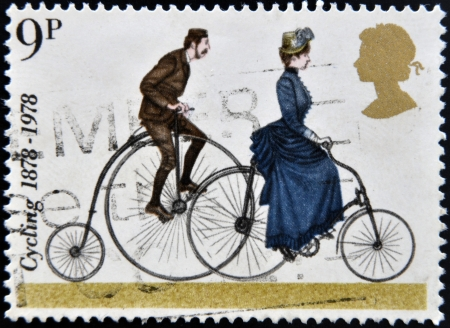 antique coins: UNITED KINGDOM - CIRCA 1978 : A stamp printed in Great Britain celebrating cycling, showing a Penny Farthing and 1884 Safety Bicycle, circa 1978