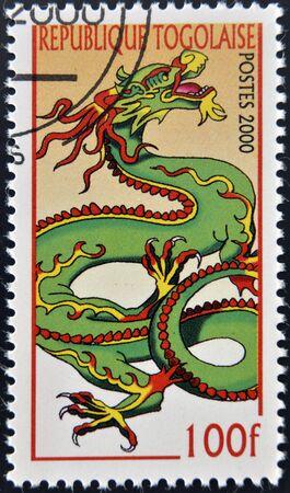 commemorate: TOGO - CIRCA 2000: A stamp printed in Togolese Republic shows dragon, circa 2000