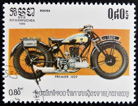postage stamp: CAMBODIA - CIRCA 1985: A stamp printed in Kampuchea shows a vintage Premier motorcycle, circa 1985  Stock Photo