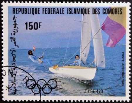 comores: COMORES - CIRCA 1983: A stamp printed in Comores dedicated to the Olympic sailing shows Type 470, circa 1983