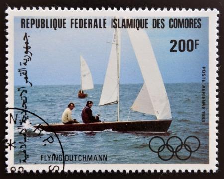 comores: COMORES - CIRCA 1983: A stamp printed in Comores dedicated to the Olympic sailing shows flying Dutchmann, circa 1983