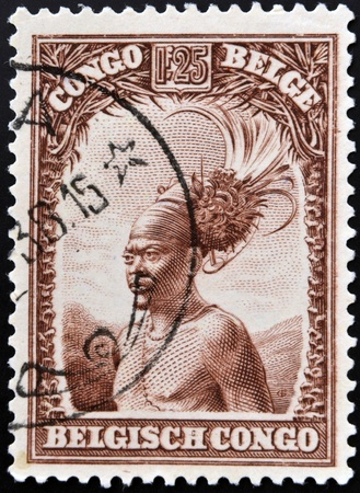 BELGIAN CONGO - CIRCA 1942: A stamp printed in Belgian Congo shows Head of a native men, circa 1942  photo