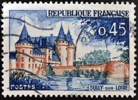 sully: FRANCE - CIRCA 1961: a stamp printed in France shows image of Sully-sur-Loire castle, the historic seat of the ducs de Sully, circa 1961