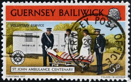 bailiwick: GUERNSEY BAILIWICK - CIRCA 1977: A stamp printed in Guernsey dedicated to St. John Ambulance Centenary, shows voluntary service, circa 1977