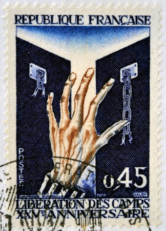 FRANCE - CIRCA 1970: A stamp printed in France dedicated to the liberation of Nazi concentration camps, circa 1970
