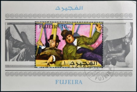 FUJEIRA - CIRCA 1972: A stamp printed in Fujeira shows the famous movie comedy duo of Stan Laurel and Oliver Hardy, circa 1972  Editorial
