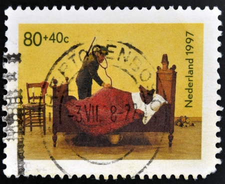 HOLLAND - CIRCA 1997: A stamp printed in Holland shows Wolf and hunter, circa 1997