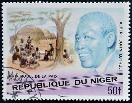 nonviolent: NIGER - CIRCA 1977: A stamp printed in Niger shows Nobel Peace Prize, Albert John Lutuli, circa 1977