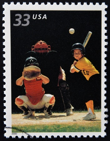 UNITED STATES OF AMERICA - CIRCA 2000: A stamp printed in USA commemorates youth team sports in America, shows baseball, circa 2000