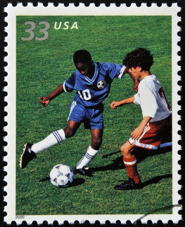 UNITED STATES OF AMERICA - CIRCA 2000: A stamp printed in USA commemorates youth team sports in America, shows soccer, circa 2000
