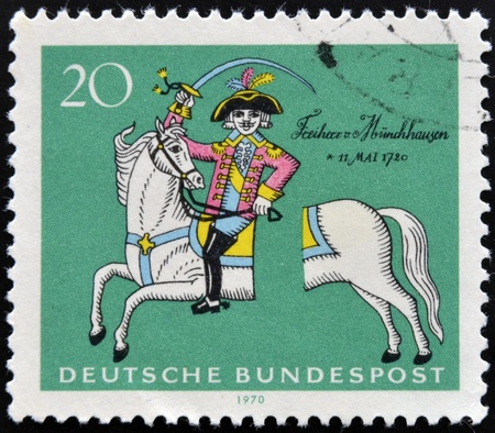 severed: GERMANY - CIRCA 1970: a stamp printed in Germany shows Munchhausen on his severed horse, soldier and storyteller Count Hieronymus C. von Munchhausen, circa 1970  Stock Photo