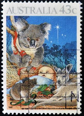 AUSTRALIA - CIRCA 1990: stamp printed in Australia, shows animals and baby, christmas, circa 1990 photo