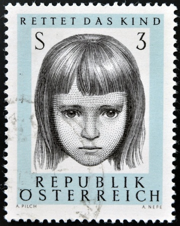 recorded: AUSTRIA - CIRCA 1966: a stamp printed in Austria shows Young, 10th anniversary of saving infant society, circa 1966