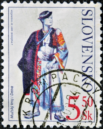 SLOVAKIA - CIRCA 2001: A stamp printed in Slovakia shows male costume Detva, circa 2001   Reklamní fotografie