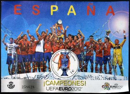 xavi: SPAIN - CIRCA 2012: A stamp printed in Spain shows the Spanish football champions of Europe, circa 2012