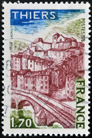 french countryside: FRANCE - CIRCA 1976: A stamp printed in France, shows image of Thiers village, circa 1976