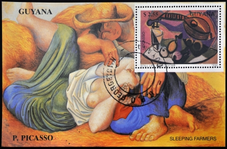 GUYANA CIRCA 1990: Stamp printed in Guyana shows still life with guitar and sleeping farmers by Picasso, circa 1990 Stock Photo - 18487597