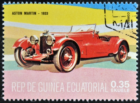 EQUATORIAL GUINEA - CIRCA 1974: A stamp printed in Guinea dedicated to vintage cars, shows Aston Martin, 1933, circa 1974