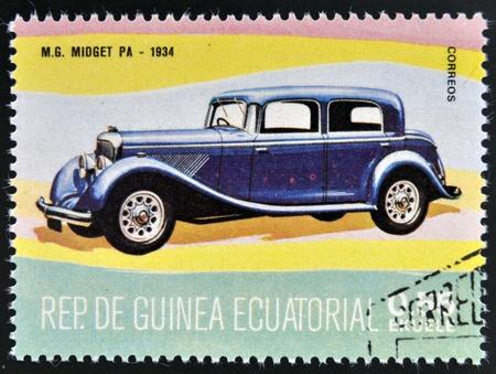 midget: EQUATORIAL GUINEA - CIRCA 1974: A stamp printed in Guinea dedicated to vintage cars, shows MG Midget, 1934, circa 1974 Editorial