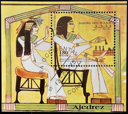 occ: SAHARA OCC RASD - CIRCA 1995: A stamp printed in Sahara OCC. R.A.S.D shows ancient Egyptians playing chess, circa 1995