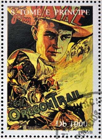 john wayne: SAO TOME AND PRINCIPE - CIRCA 1995: A stamp printed in Sao Tome shows movie poster The Oregon Trail, circa 1995