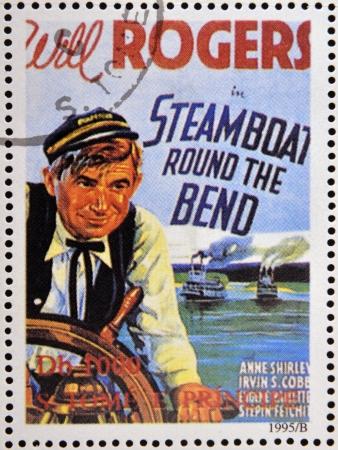 tomo: SAO TOME E PRINCIPE - CIRCA 1995: Un timbro stampato in Sao Tome mostra poster film Steamboat Round the Bend, circa 1995